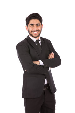 Happy handsome young businessman smiling and standing confidently, guy wearing black suit and black tie, isolated on white background