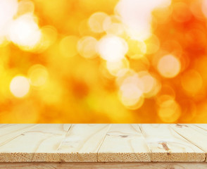 Wood table top on shiny bokeh gold background  for display  your products