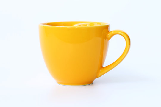 Yellow coffee cup on White background.