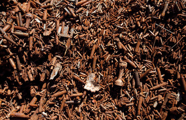 A pile of recyclable bullet casings used for the production of copper wires is seen at a foundry in Peshawar