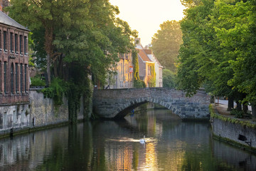 Belgium, West Flanders (Vlaanderen), Bruges (Brugge). Brugse Vrije and buildings along the Groenerei canal at dusk.