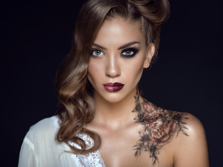 Close up portrait of beautiful model with artistic make up and hairstyle. Floral body art on her shoulder. Ideal woman concept. One half symbolizes a good housewife, another one – a passionate lover Wall mural