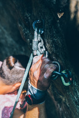 Climber Man Climbing On The Rock, Close-up Of Hand With Tape In Magnesium Powder