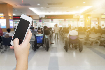 women hand holding smart phone to call relative to wait while waiting for receive medicine. medical emergency call concept. patient using mobile while wait to pay for bill.