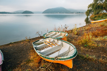 Two Wooden Boats on Lake Shore