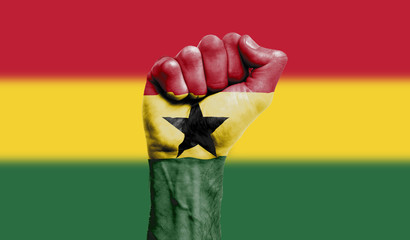 Ghana flag painted on a clenched fist. Strength, Power, Protest concept