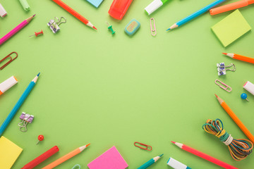 School office supplies on a green background