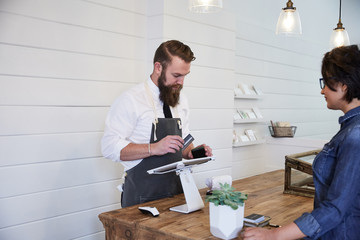 Customer buying items at an artisan shop with credit card