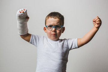 Kid Posign Tough with Arm Cast