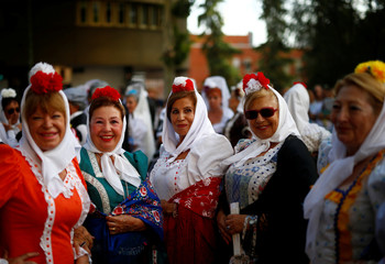 """Women dressed in Madrid's traditional attire """"Chulapa"""" take part in the feast of La Paloma Virgin in Madrid"""