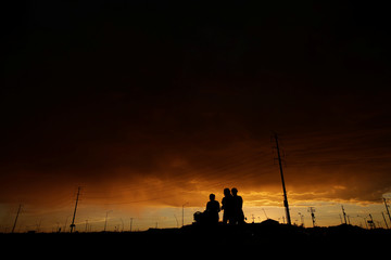 High voltage power line and light poles are pictured after sunset in Ciudad Juarez,