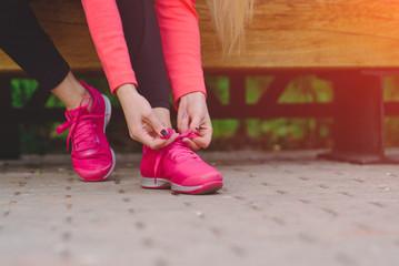 Girl ties up her shoelaces