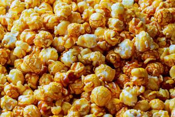 Hundreds popcorns background. Popcorns behind