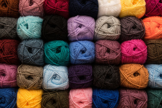Various colors yarn on background