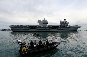 Royal Navy's new aircraft carrier HMS Queen Elizabeth arrives in Portsmouth