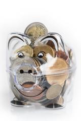 Piggy bank, euro coins. Money saving concept. Banknotes closeup, isolated white background.