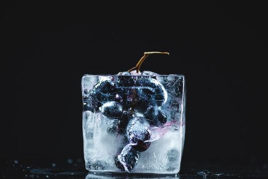 frozen grape in ice cube