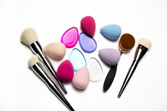 Set of makeup brushes, beauty blenders, silicone sponges and oval brush