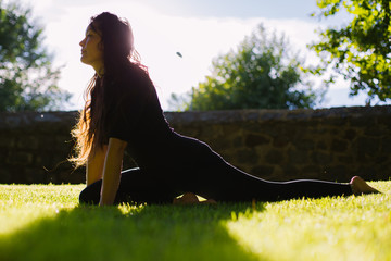 Young woman practicing yoga outdoors