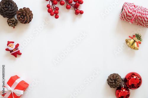 christmas and new year background frame made of christmas decoration with pine cones holly