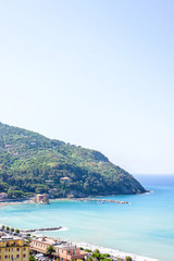 Beautiful daylight view to green mountains, blue sea and buildings of Levanto, Italy. Cinque Terre beauties