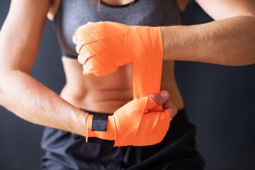 Closeup Female Hands Wearing Boxing Bandages Wall mural