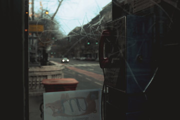 Telephone booth in city