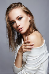Beautiful woman with wet hair and make-up