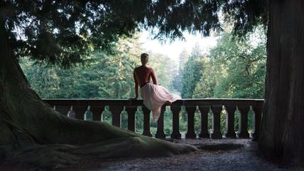 girl sitting on balustrade enjoying view