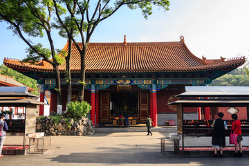 Traditional Buddhist temple in China with worshippers