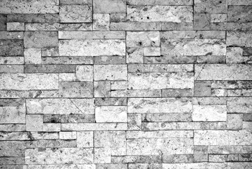Puzzle brick grunge texture wall background. Haunt and horror. Rough and mess. Black and white colors. Close up.