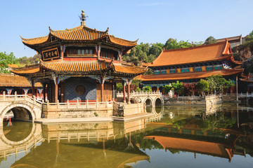 Fotobehang China Traditional Chinese architecture with reflections in a pond in Confucius Buddhist temple