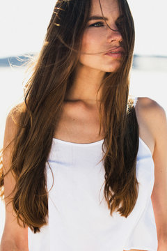 Portrait of brunette woman with long shiny hair