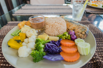 Obraz set rice Spicy Shrimp Paste and Chill Sauce Served with Mixed colorful  Vegetable in plate .(Nam Prik Ka Pi) - fototapety do salonu