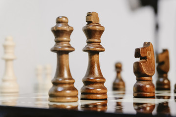 Business and leadership concept, king and queen as a leader.Chess pieces on board with reflection