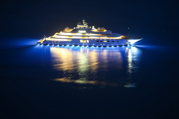An illuminated luxury yacht in the Adriatiac sea at night in Dalmatia, Croatia.