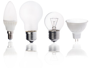 four different electric lamps with reflection