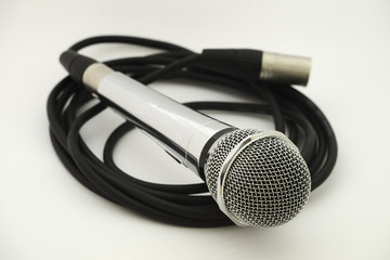 vintage microphone with wire on white