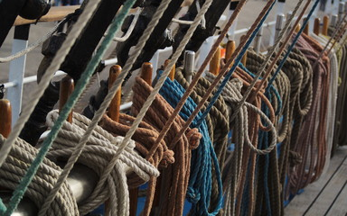 Marine ropes attached to rigging on deck of a tall ship