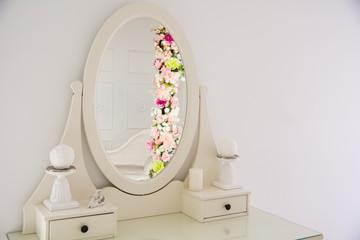 Interior retro ladies' table with a round mirror