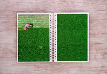 Open book with harvest scene