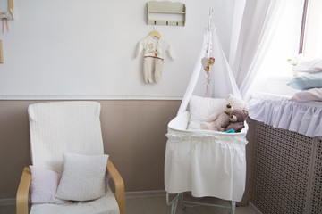 Interior of a nursery with a crib for a baby.