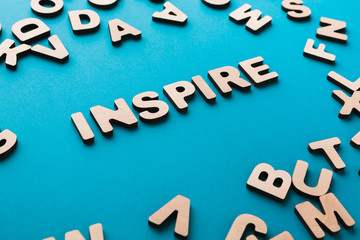 Word Inspire on blue background