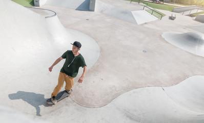 skateboarder guy in action in skate park
