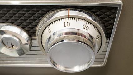 Silver safe lock button or safe dial. Security concept.