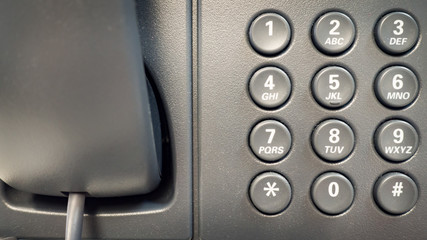 Closeup dial telephone keypad concept for communication, contact us and customer service support.