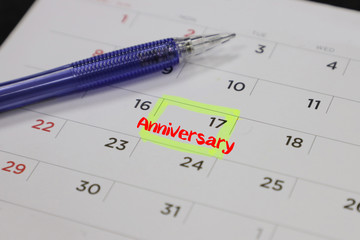 highlighter with a circled anniversary day on calendar