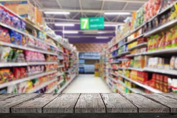 Empty wood Shelf on supermarket store background