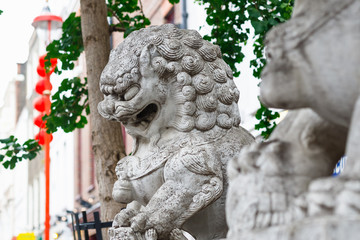 A guardian lion statue in London Chinatown