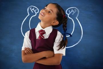 Composite image of thoughtful schoolgirl looking away